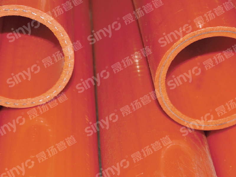Perforated steel strip power composite pipe